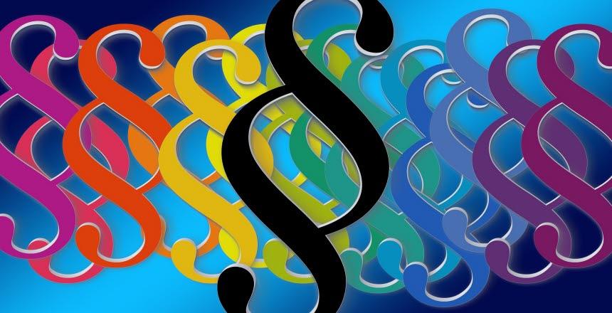Illustrerad bild med massor av paragraftecken i olika färger
