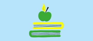 Grönt äpple står uppe på två böcker.