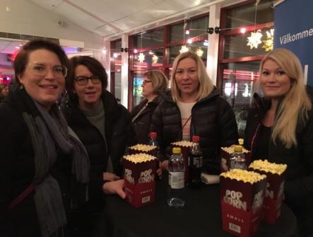 Medlemmar med popcorn